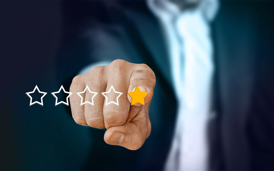Person pointing at one star rating